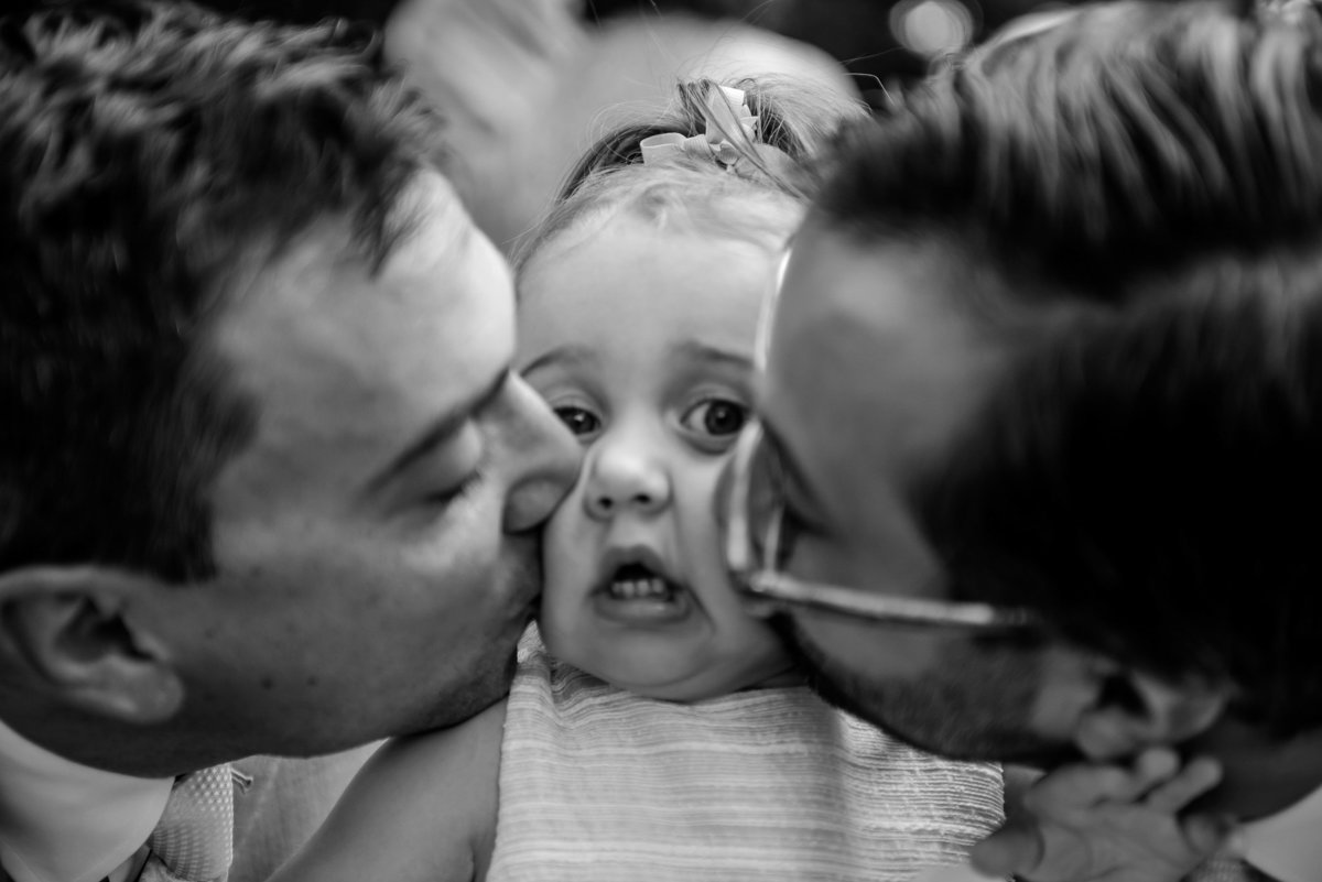 Brooklyn Wedding Photographer | Rob Allen Photography | Destination Wedding Photographer at Mt. Sinai New York groom and brother kissing grooms bothers niece