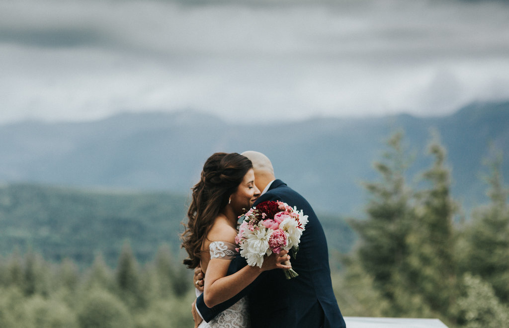 Bride and Groom embrace after their elopement ceremony in the Olympic National Park in Port Angeles, Washington.