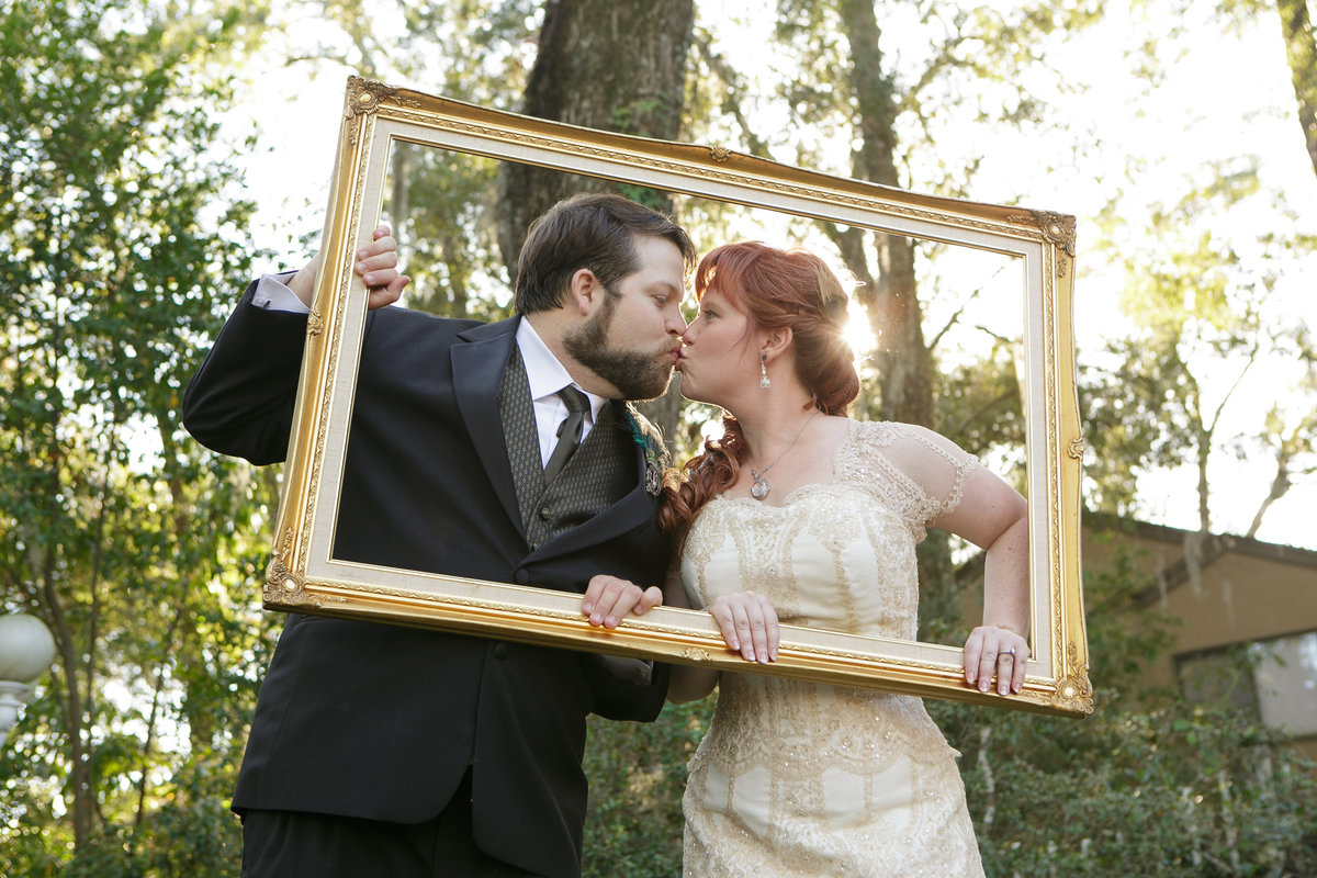 Bride and groom kissing in a frame
