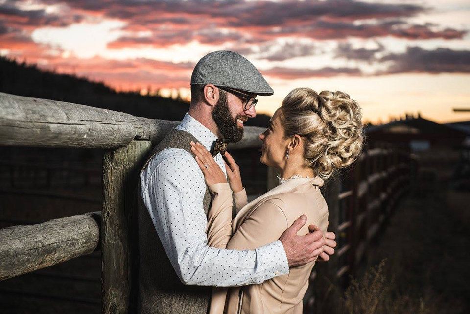 Granby-colorado-strawberry-creek-ranch-hipster-mountain-wedding-bride-and-groom-hugging