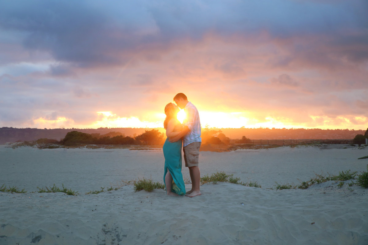 Couple at sunset engagement session at Coronado beach, California