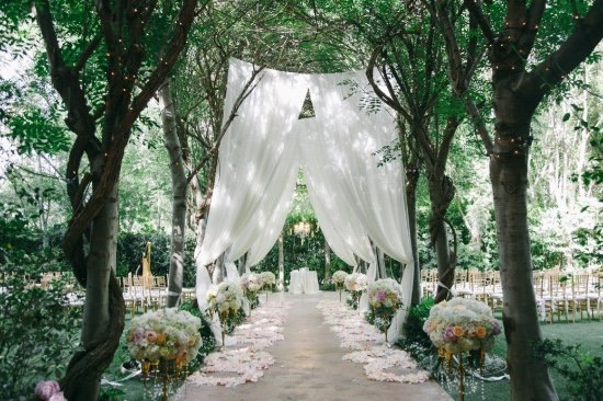 outdoor wedding ceremony with draping