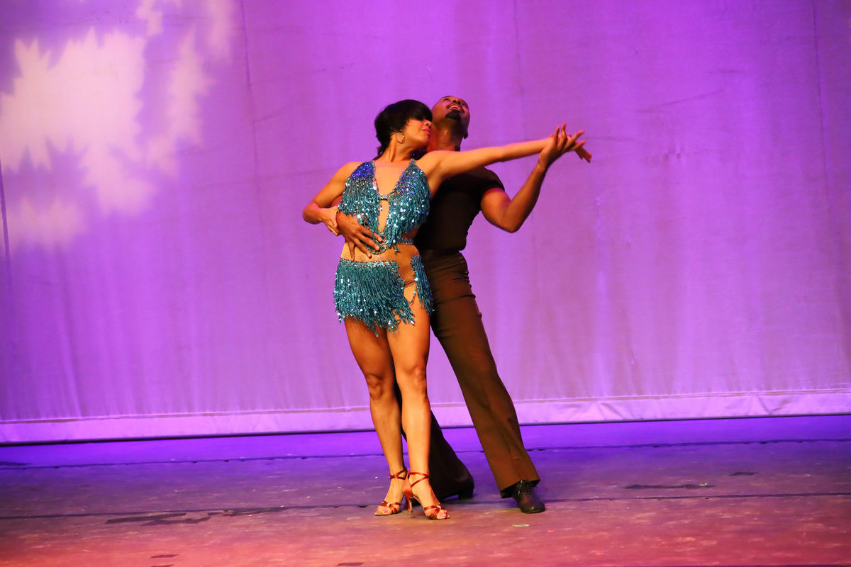 Male and female latin dance couple perform on stage. Photo by Ross Photography, Trinidad, W.I..