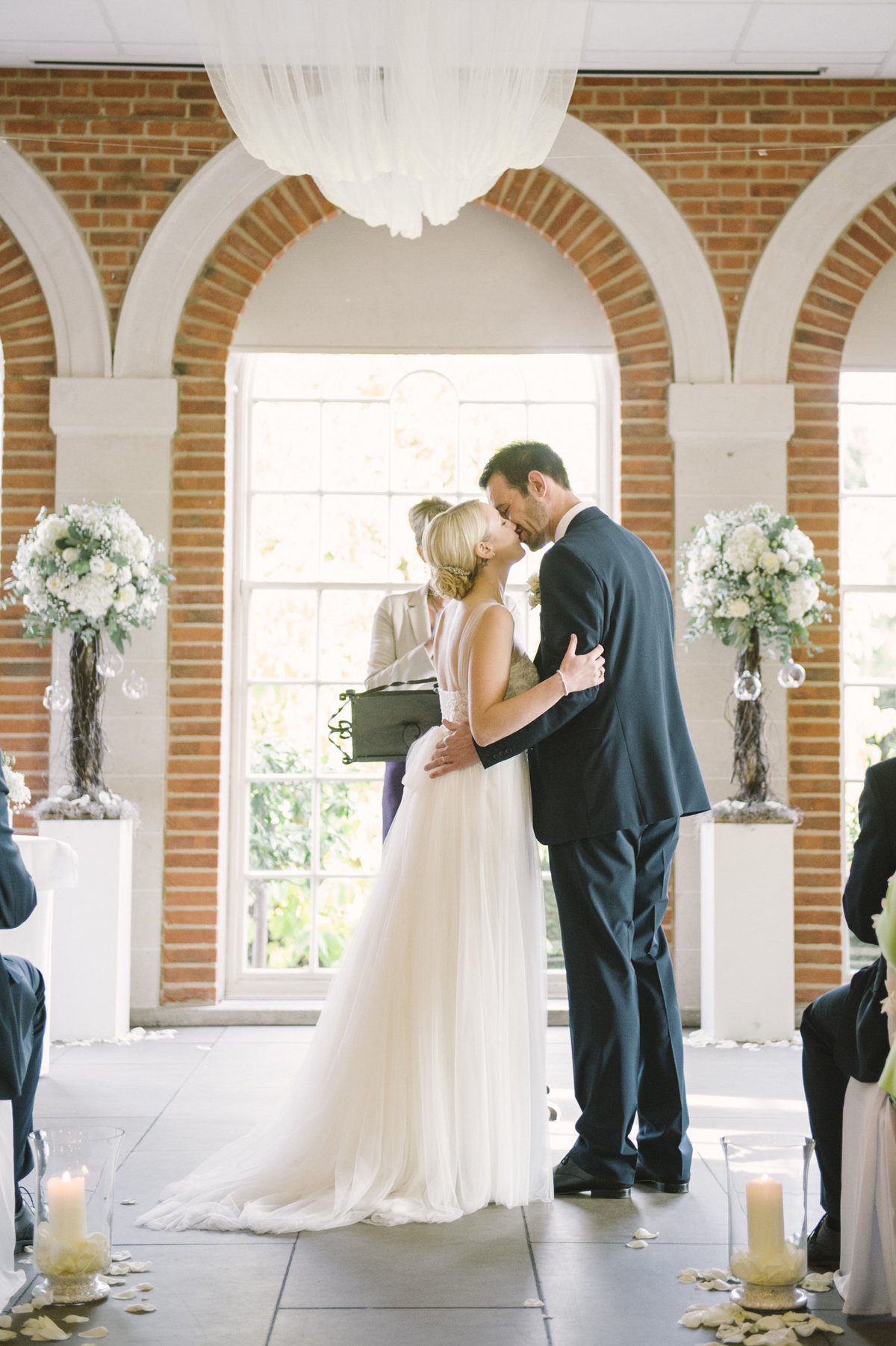 bride and groom kissing at great fosters hotel wedding