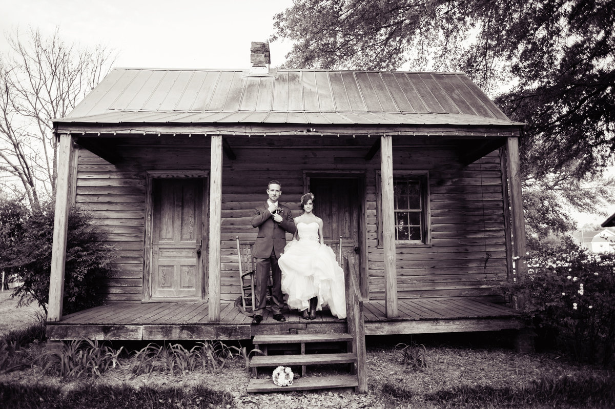 bride and groom on old cabin at poplar grove plantation