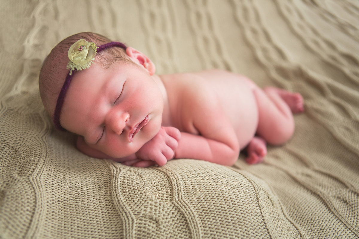 Resting her head on her arms newborn photo  by Knoxville Wedding Photographer, Amanda May Photos.