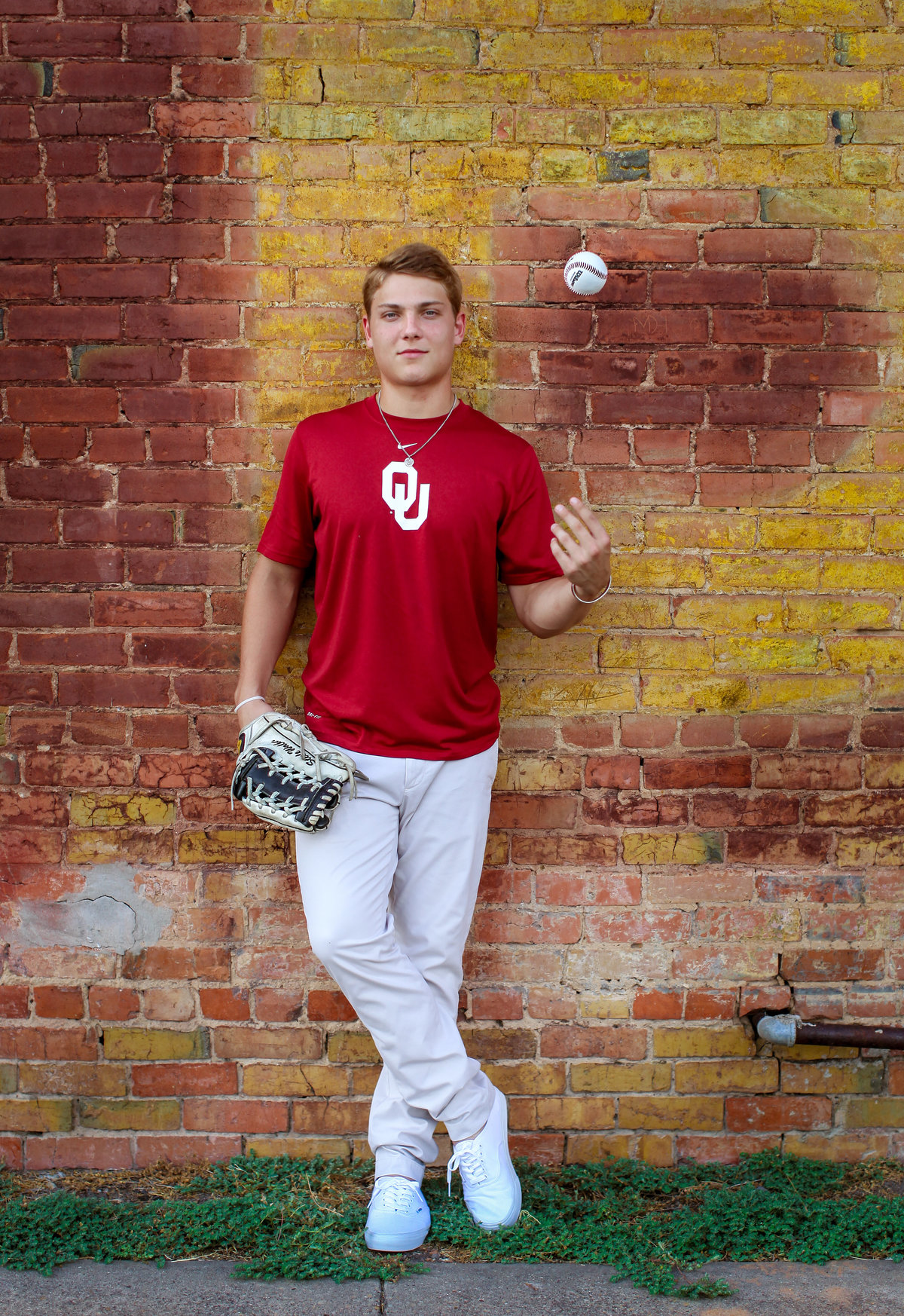 Steel Walker White Sox Senior Portrait in OU baseball uniform with ball and glove
