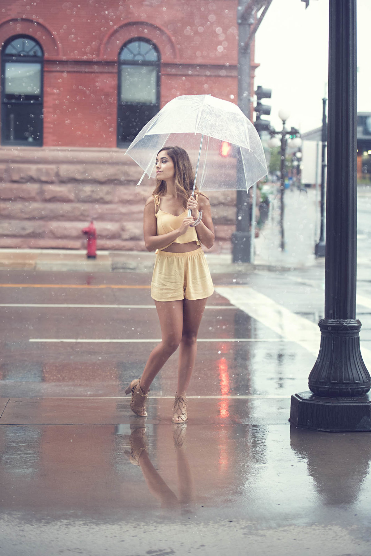 Senior picture in rain with umbrella in St. Paul