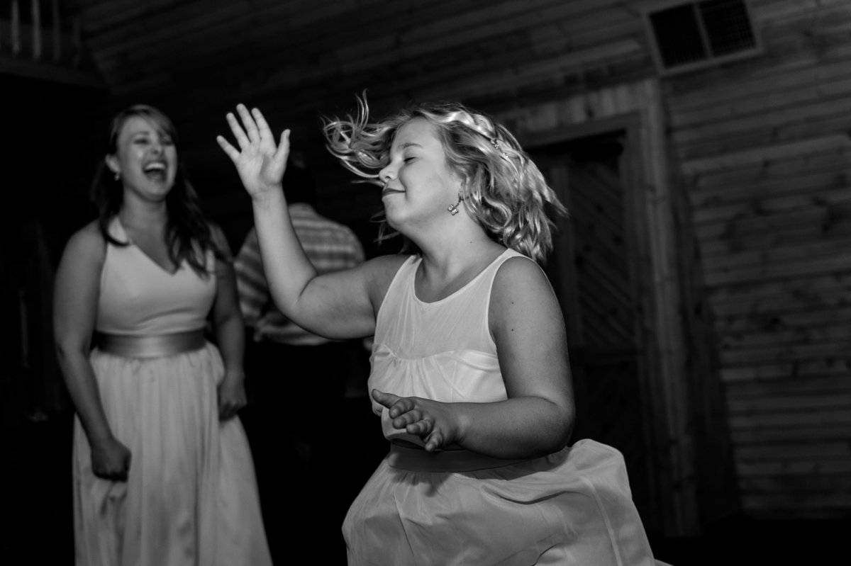 young girl dances freely at reception