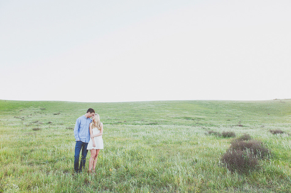 Orange County field portrait with engaged couple