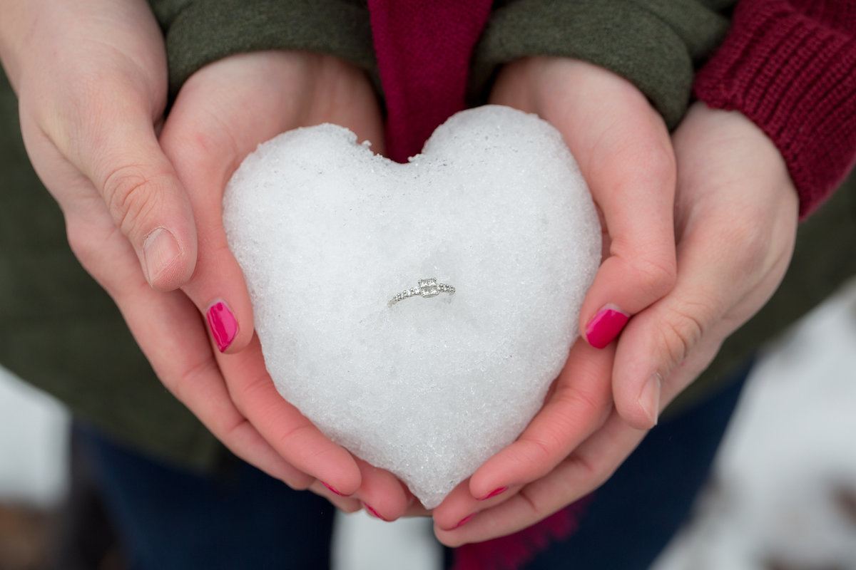 engagement ring photos in snow  Lynette Smith Photography