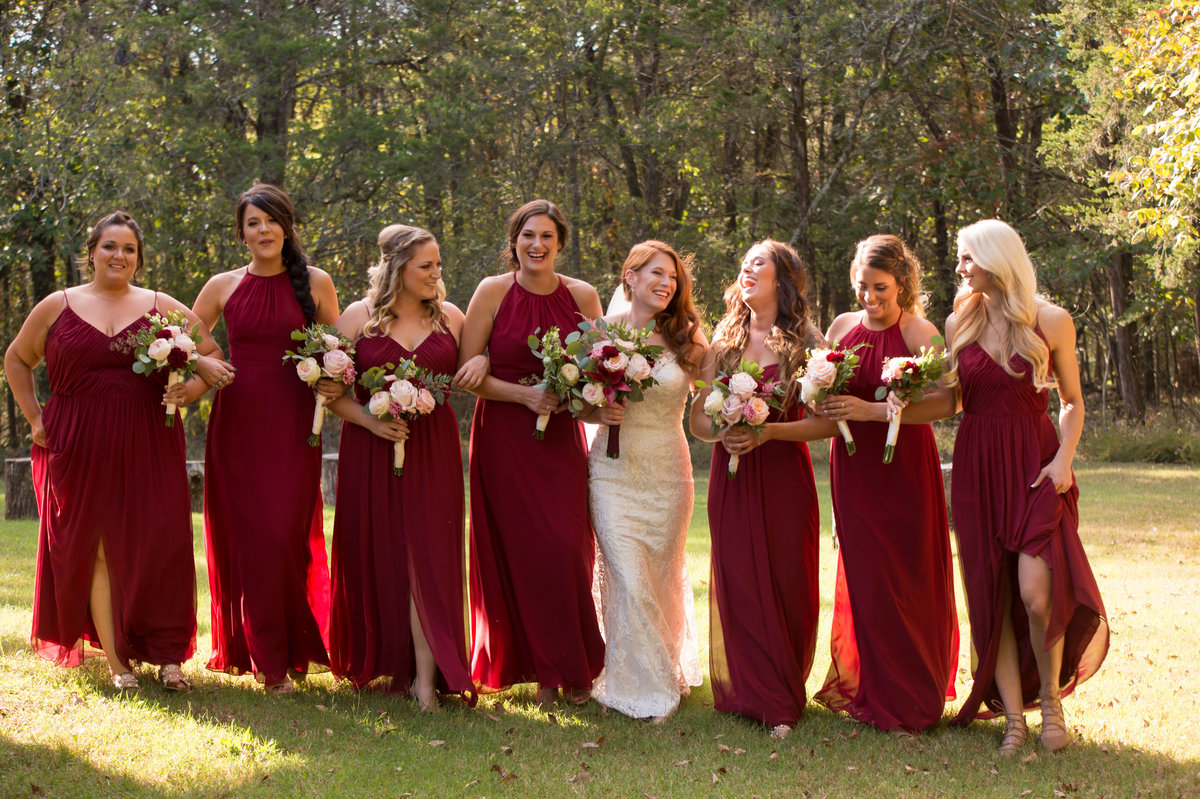 Bride and bridesmaids at fall wedding