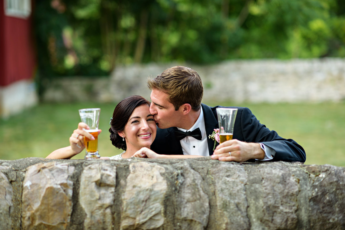 A newly married couple share a beer after the ceremony at The Manor House at Prophecy Creek.