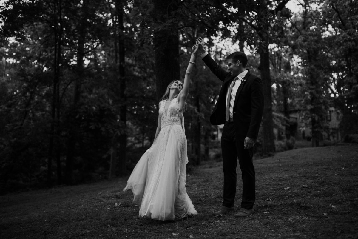 Wedding couple dancing in the woods
