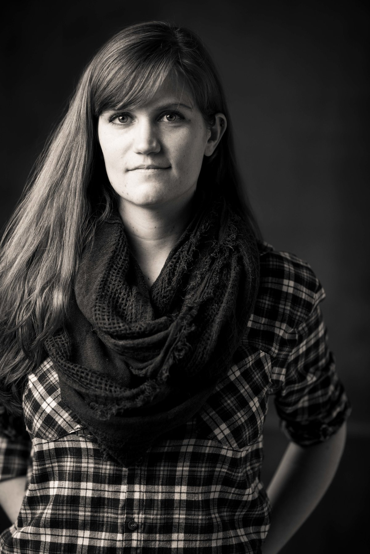 Chicago studio portrait, woman in flannel shirt and scarf.
