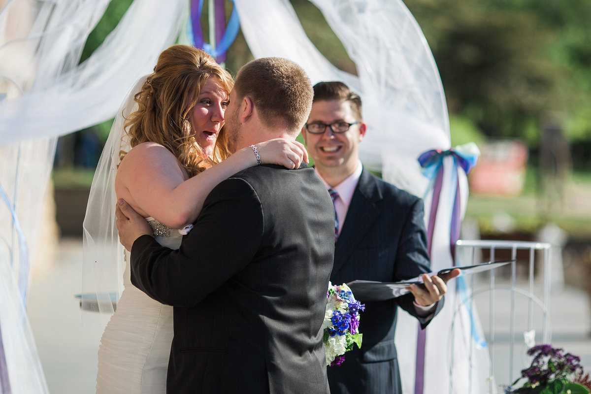 bride very happy with first kiss from her husband