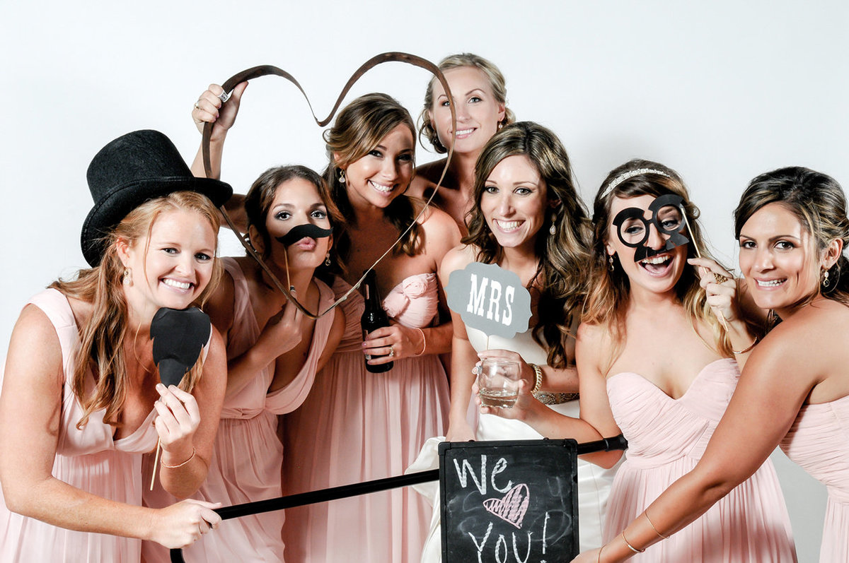 0022-Photo-Booth-Rental-at-Wedding-Reception-Guests-Having-Fun