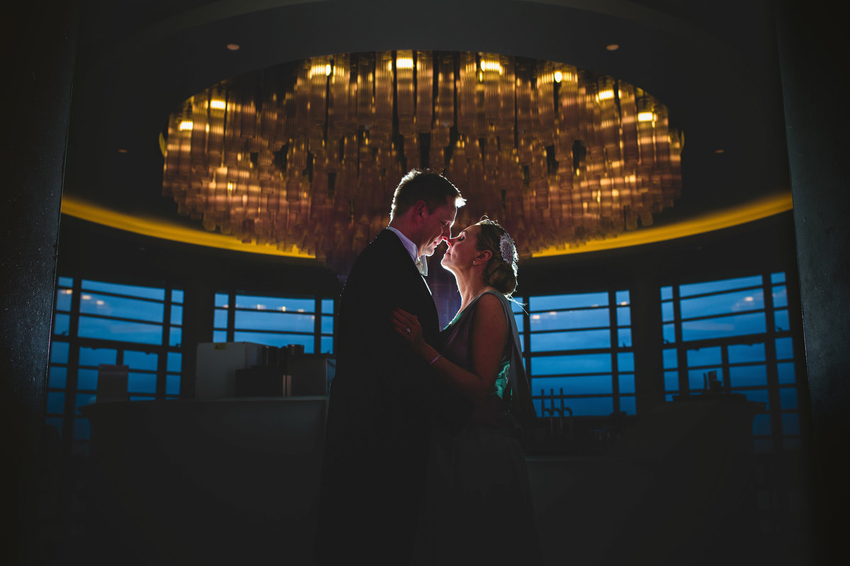 backlit photo of bride and groom in midland hotel morecambe, an art deco wedding venue