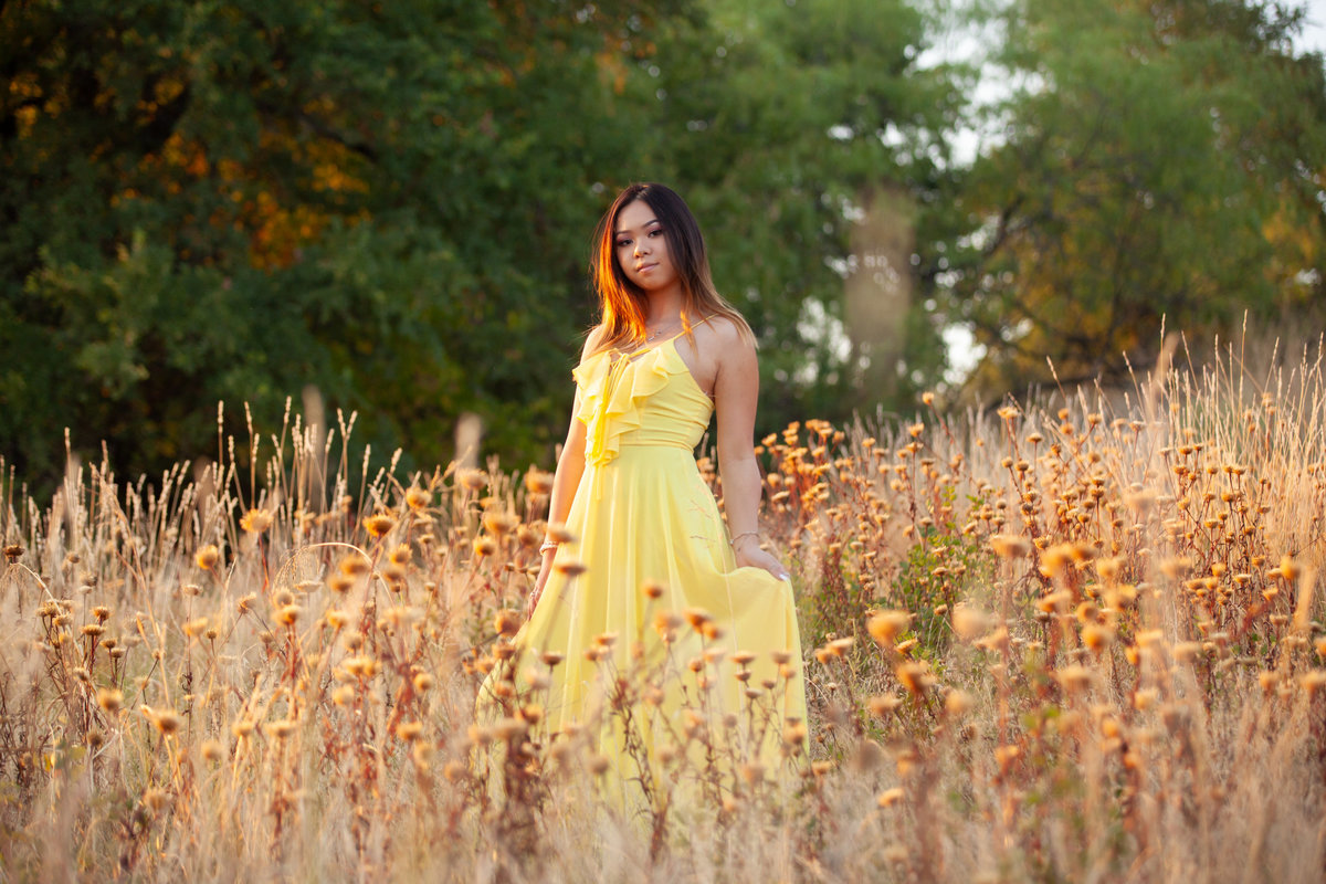 High School Senior in yellow dress in field of flowers at Arbor Hills Nature Preserve, Plano, TX