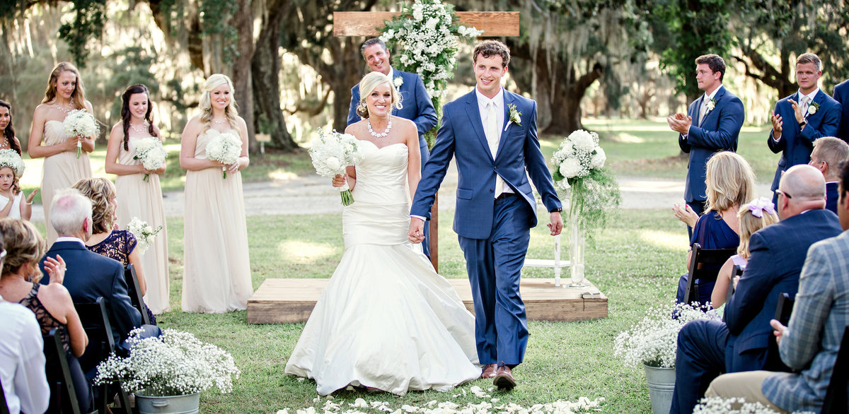 Bride and Groom exiting their ceremony on a plantation in Charleston, SC by Knoxville Wedding Photographer, Amanda May Photos