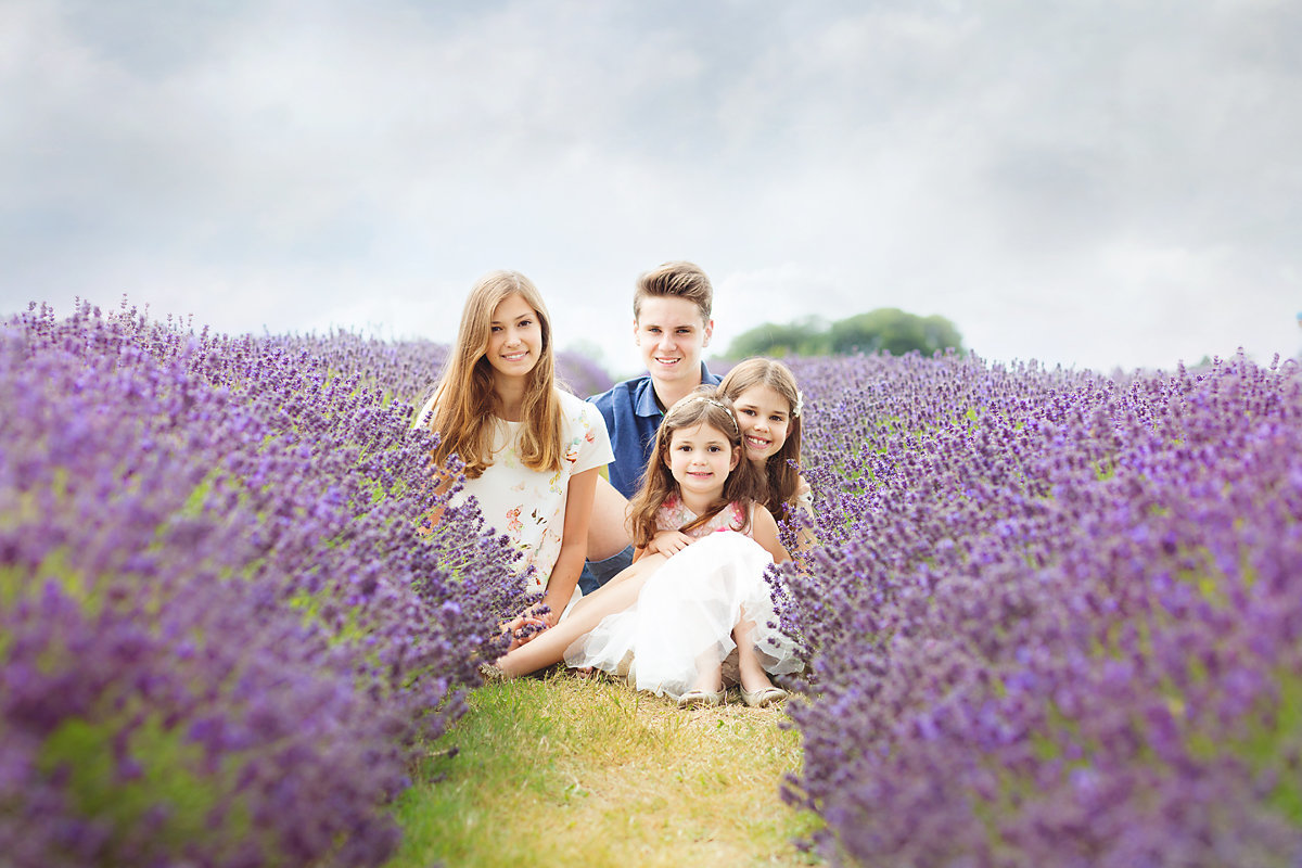 siblings sitting in Lavender field