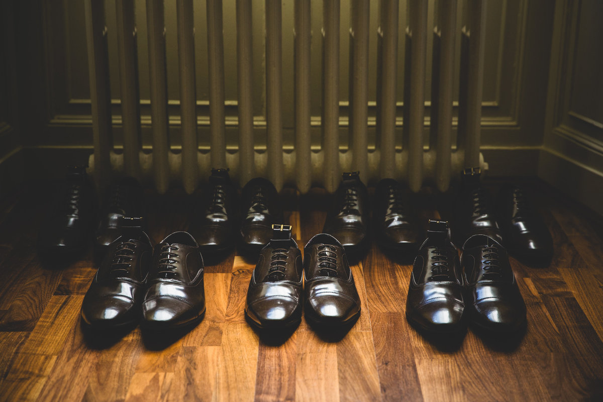 the groomsmen shoes laid out