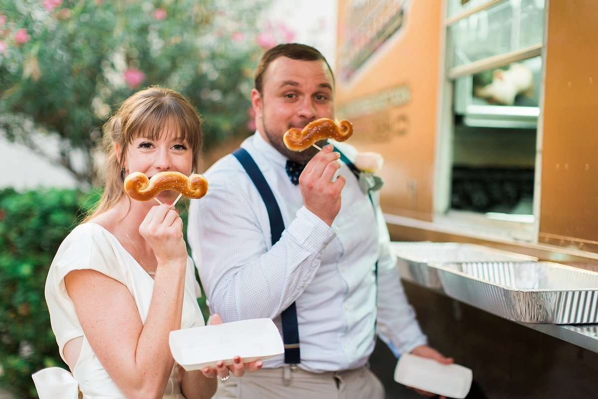 bride at groom with mustache pretzels at arcadia backyard wedding