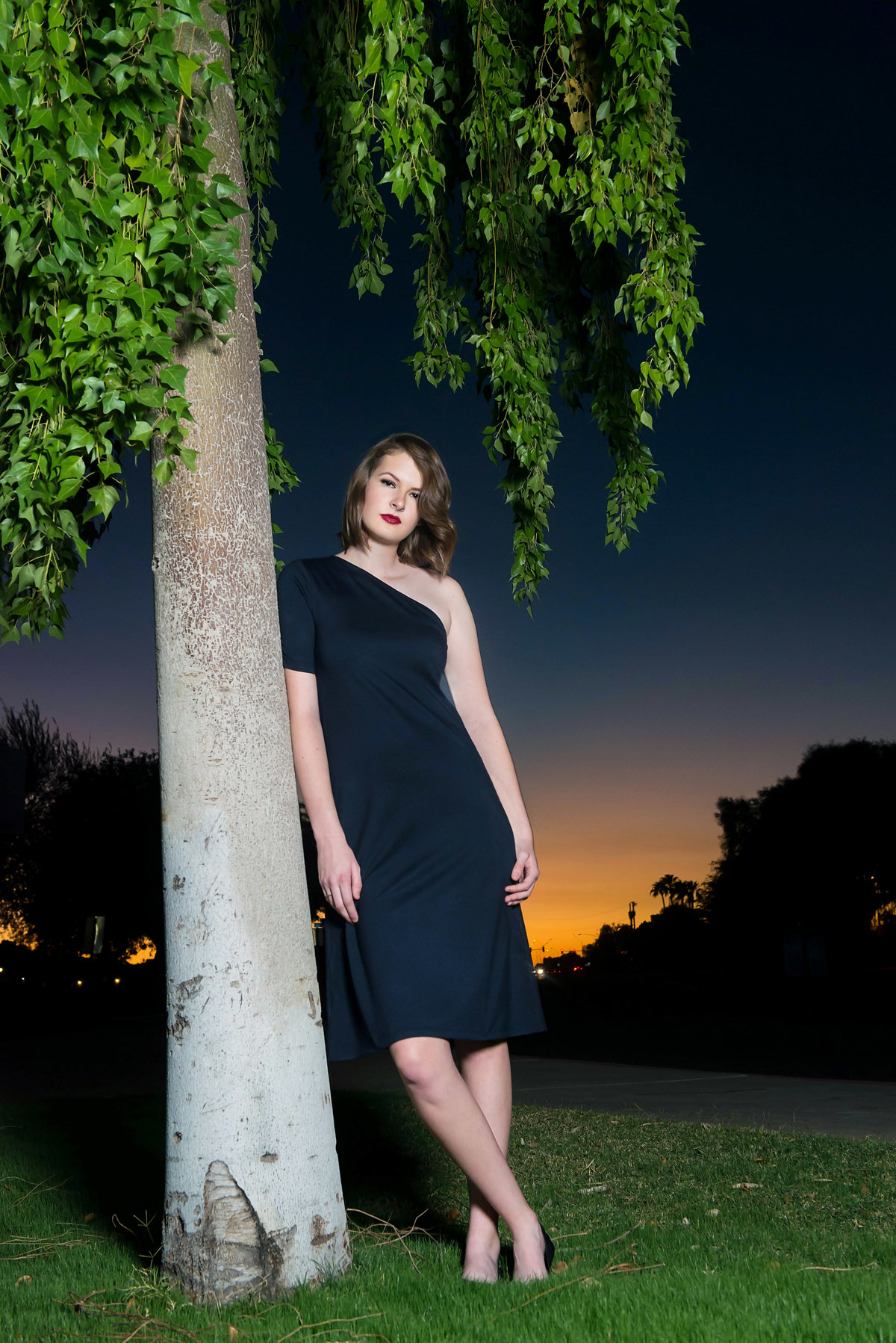 senior with sunset and black dress