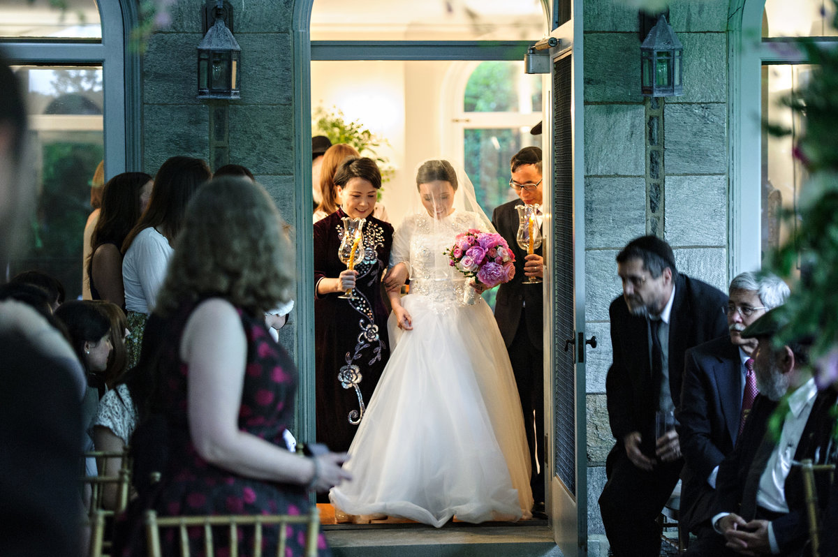A bride is walked down the isle by her parents at this intimate ceremony in Merion Station.