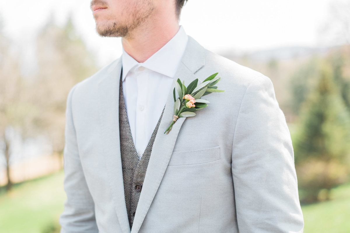 close up of groom's boutonniere