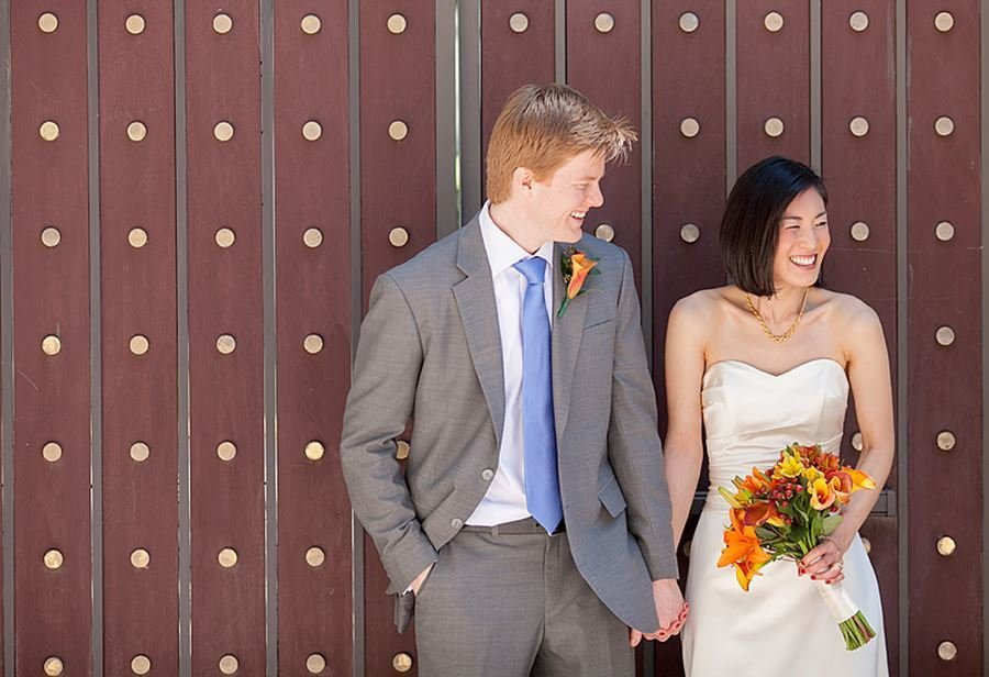 ft lauderdale red haired man and asian bride standing together laughing