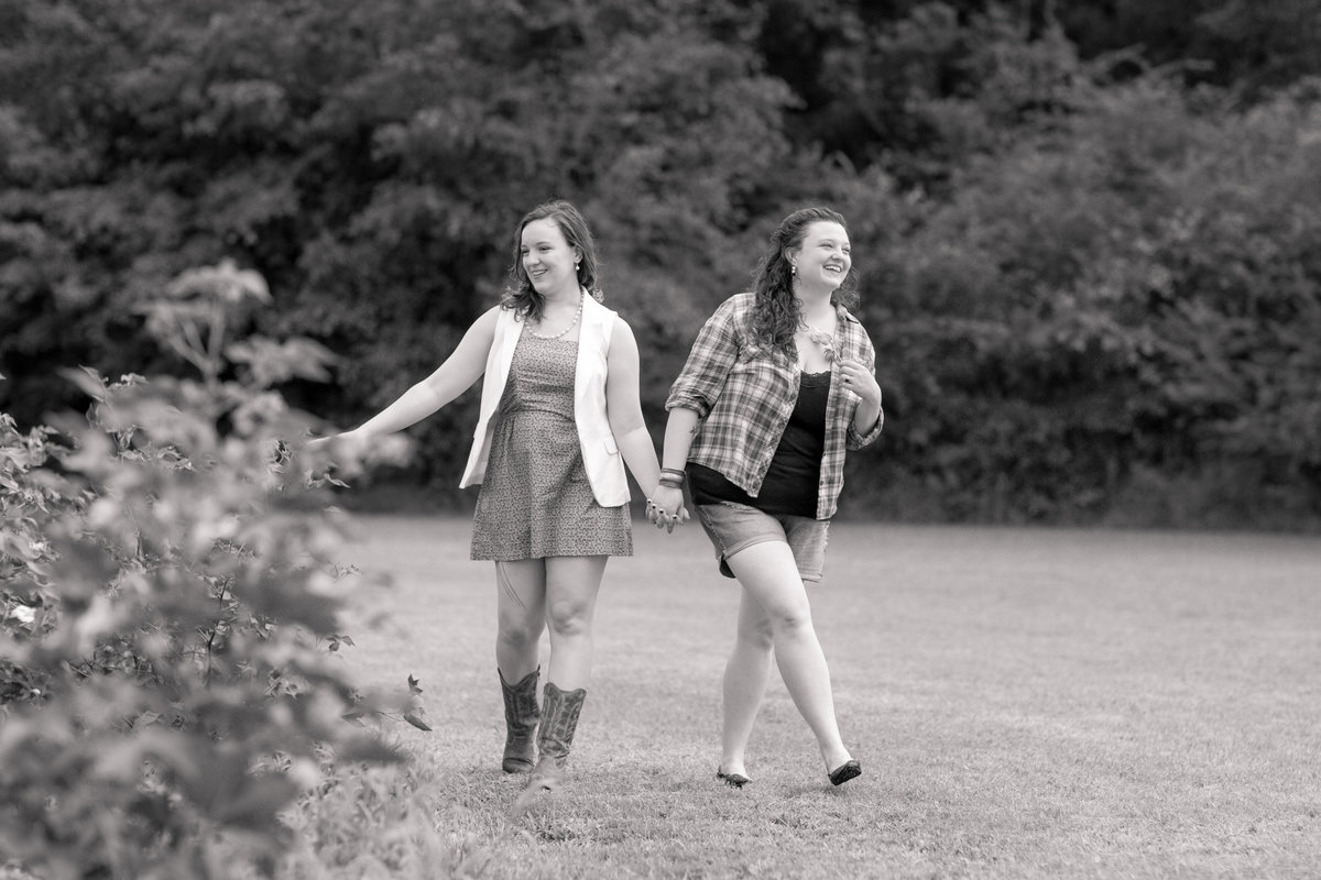 lesbian couple walking in field