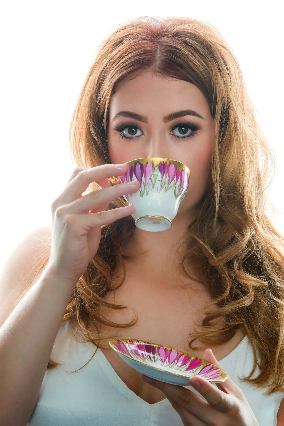 senior in studio with tea cup