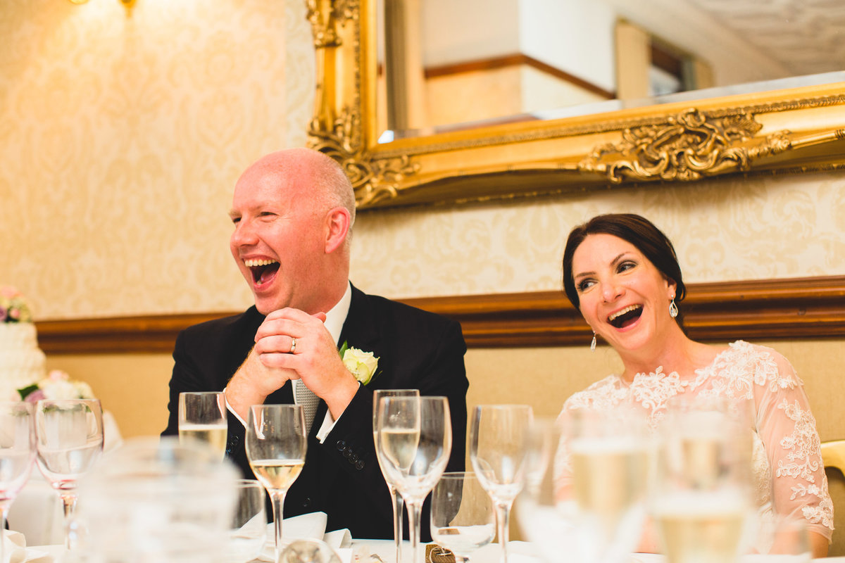 bride and groom laughing in the speeches at nunsmere hall