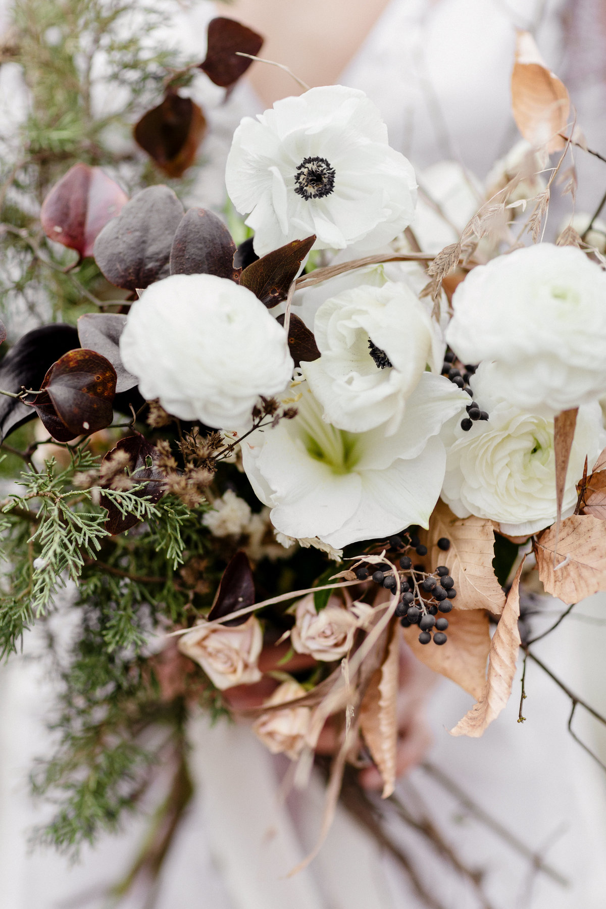 Winter bridal bouquet from Eothen and dress from Loho Bride