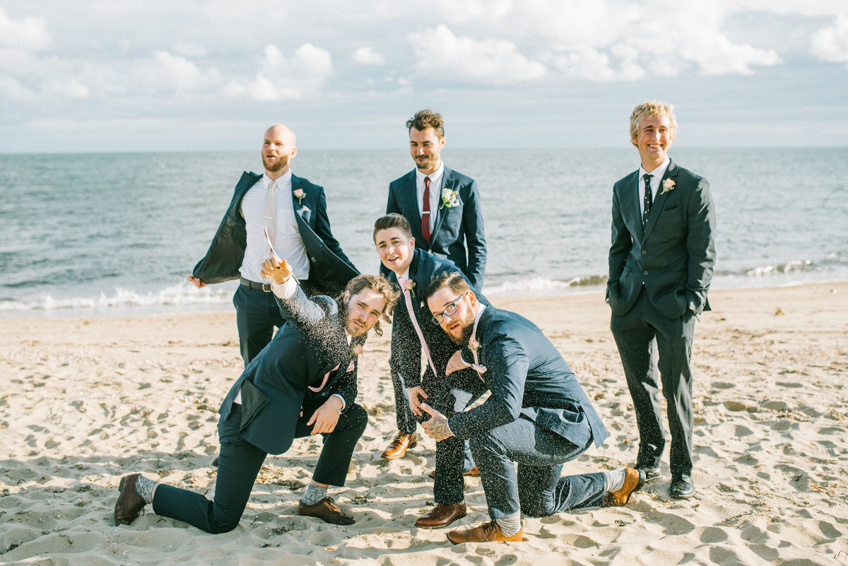 cape cod wedding groomsmen by ocean