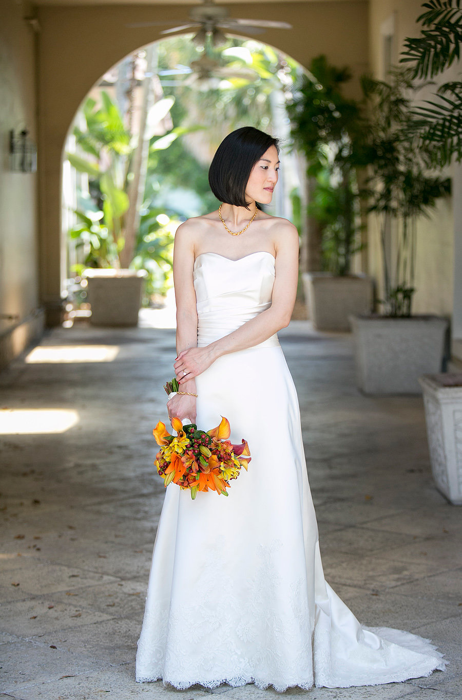asian bride with orange flowers