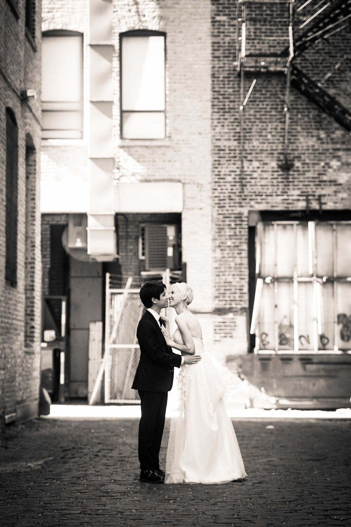 Bride and groom kiss, urban portrait, Chicago IL.