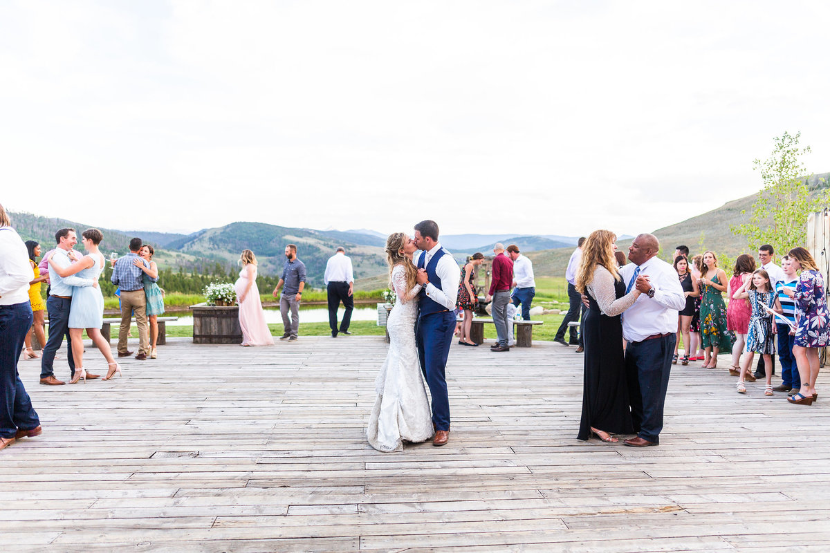 Strawberry-Creek-Ranch-Wedding-Ashley-McKenzie-Photography-Romantic-Mountain-Affair-Navy-Blush-Colorado-dancing-on-the-deck