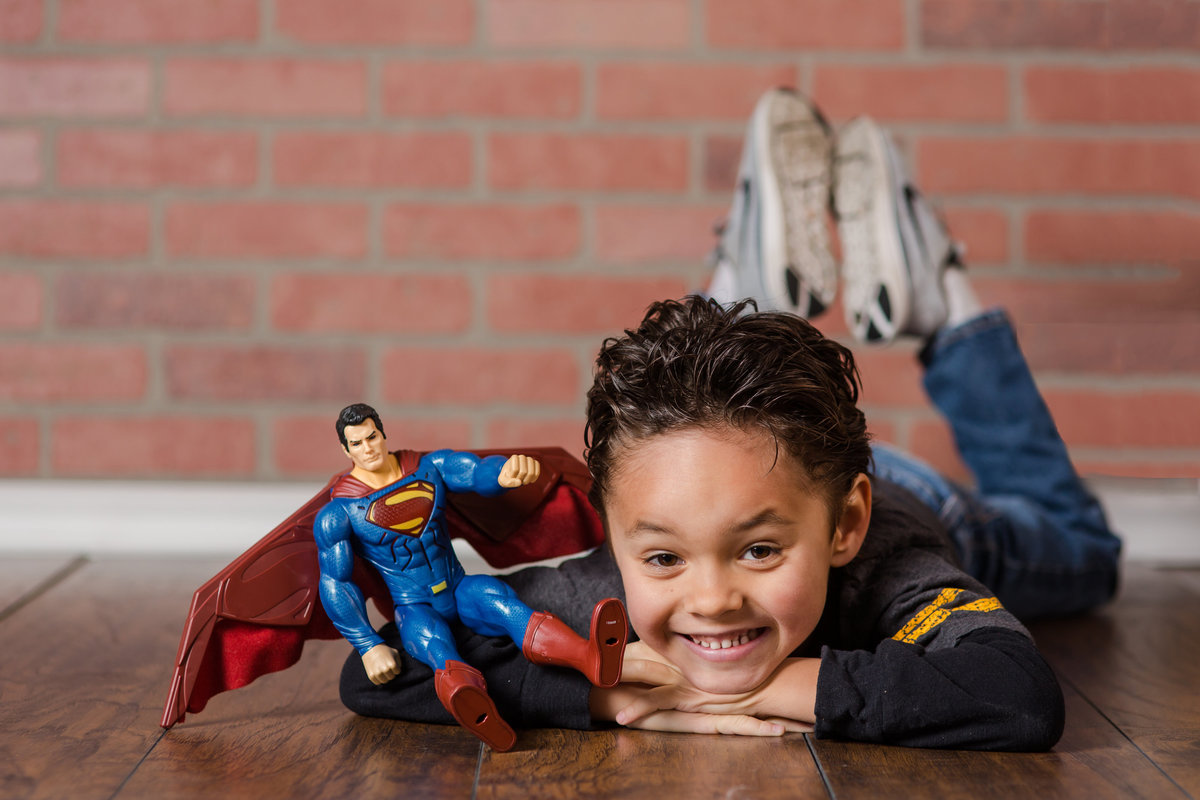 kid with toy superman