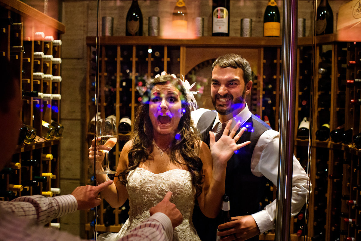A bride and groom are caught in the wine cellar at Union Trust Wedding.