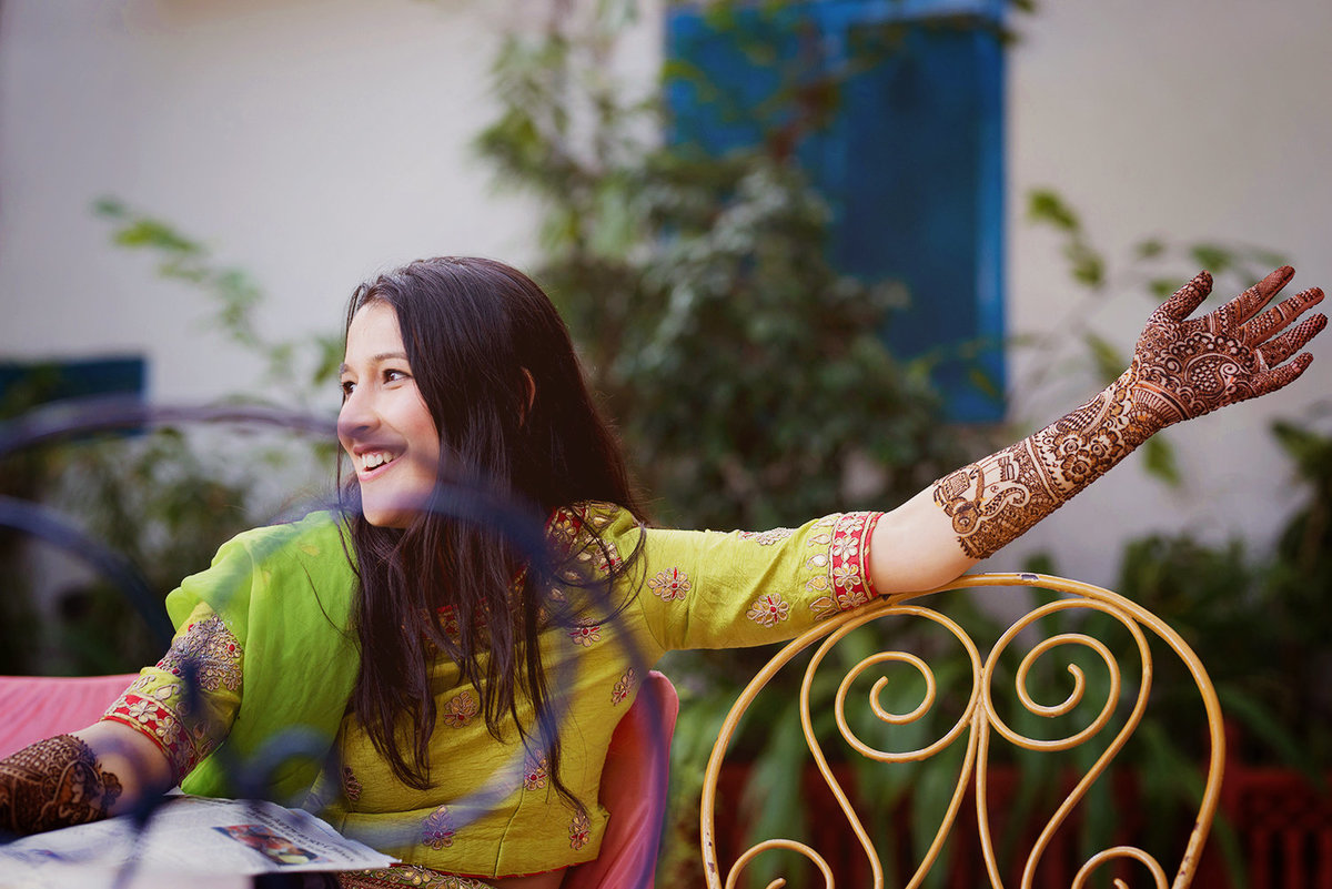 Divya applies her mehendi at the DIGGI PALACE hotel in jaipur