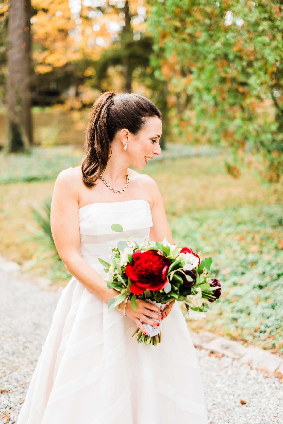 bride with bright red bouquet photo