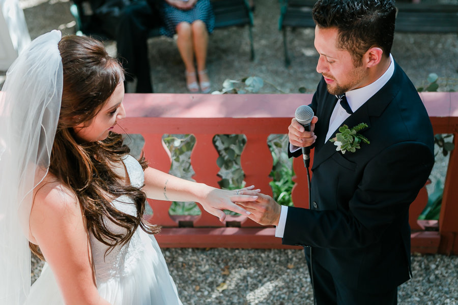 Newlyweds exchange rings during ceremony at Nature Friends LA