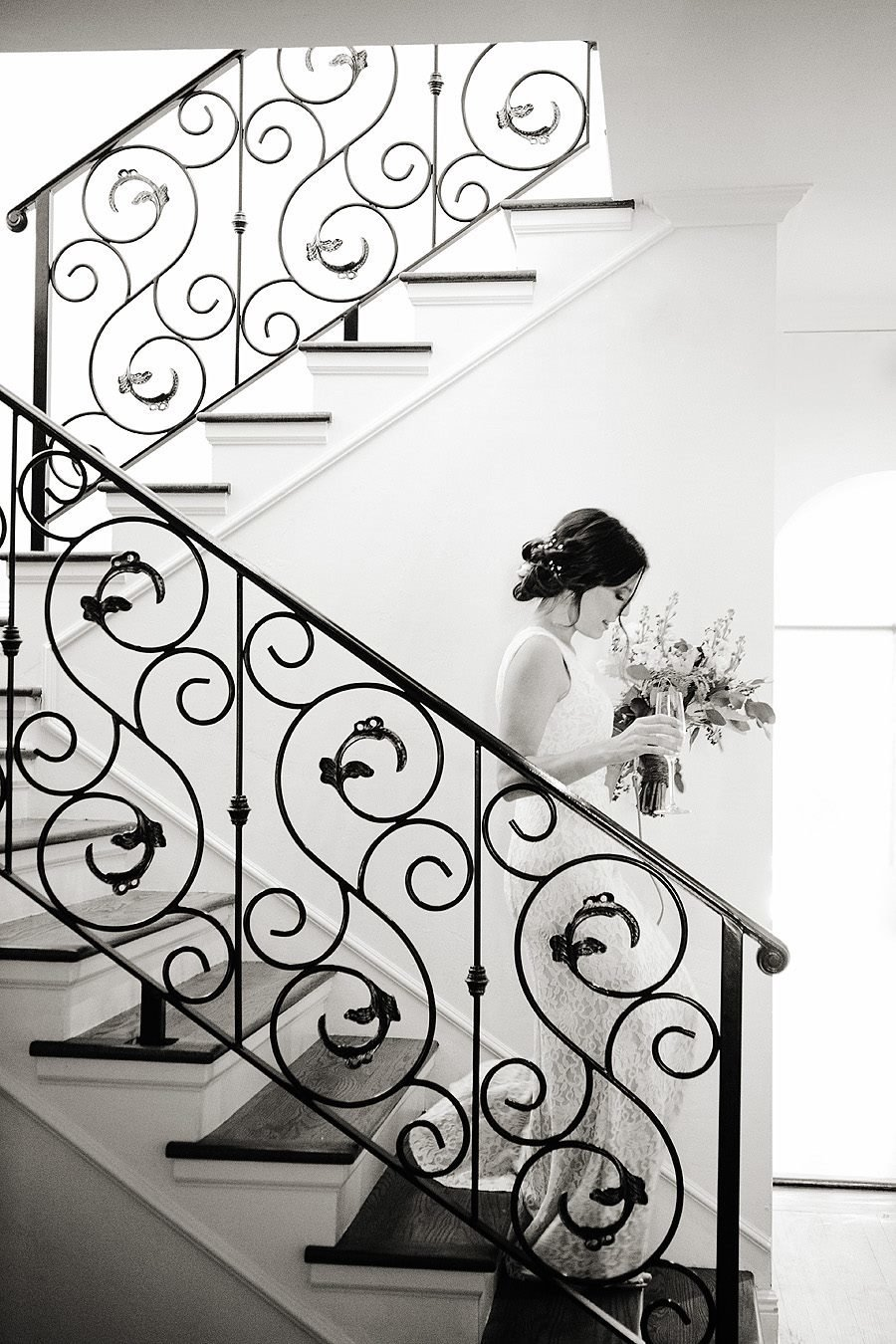 bride is walking down stairs