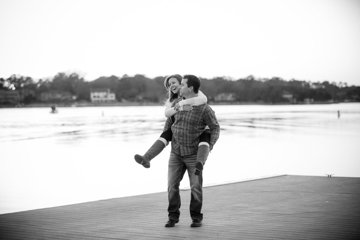 couple having fun by the water