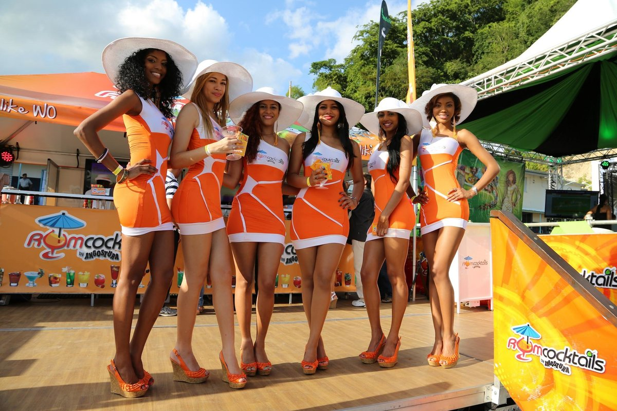 Six promotional girls pose during an event. Photo by Ross Photography, Trinidad, W.I..