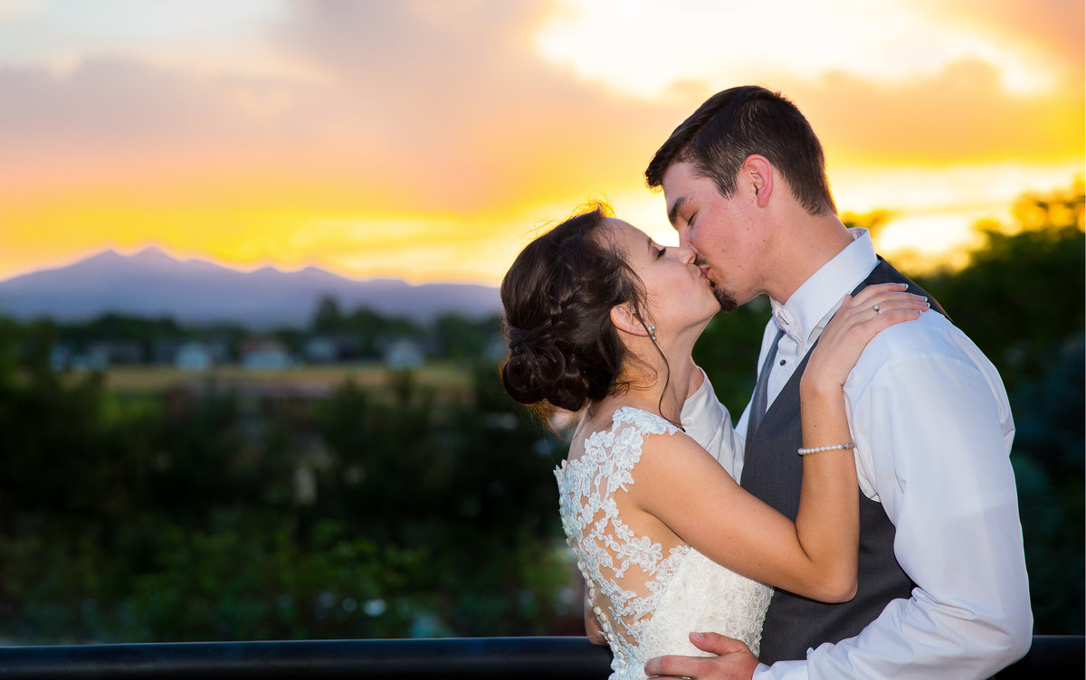 romantic-sunset-bride-and-groom-kiss-photo