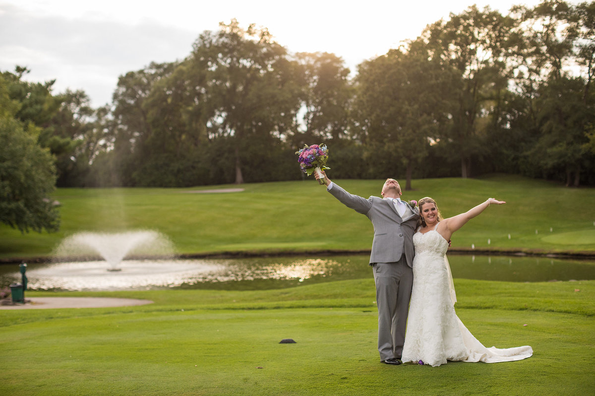 bride and groom celebrating at rockford country club in rockford illinois