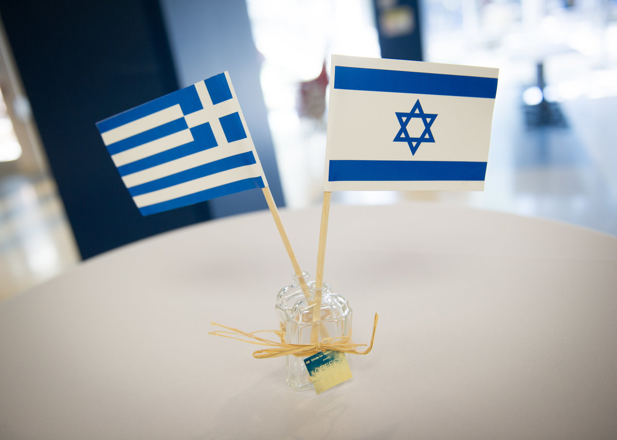 Table setting, Greek and Israeli flags, Chicago event.